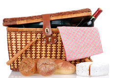 Picnic basket with bread cheese and wine. Closeup of a Picnic basket with bread cheese and wine Stock Photo