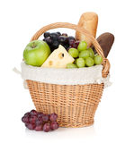 Picnic basket with bread and fruits Stock Photography