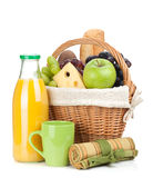 Picnic basket with bread, fruits and orange juice bottle Stock Photography