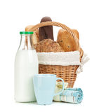 Picnic basket with bread and milk bottle Stock Image