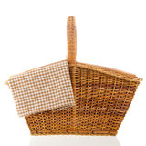 Picnic basket. With brown checked napkin isolated over white background Royalty Free Stock Photo