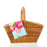 Picnic basket. With colorful napkin isolated over white background Stock Photo