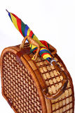 Picnic basket with a colorful umbrella on top. Picnic wicker basket with a colorful umbrella on top Royalty Free Stock Image