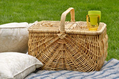 Picnic basket and cushions Royalty Free Stock Image