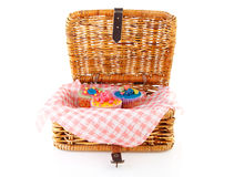 Picnic basket with decorated cupcakes Stock Image