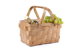 Picnic basket filled with grapes and wine Royalty Free Stock Photography