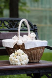 Picnic basket and flowers bouquet Royalty Free Stock Images