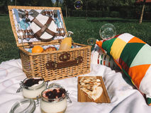 Picnic Basket Food On Blanket And Soap Bubbles. Picnic Basket Food On Blanket With Pillows And Soap Bubbles Royalty Free Stock Images