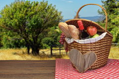 Picnic Basket With Food And Drink On The Wood Table Royalty Free Stock Images