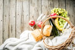 Picnic basket with fruit bread and wine stock images