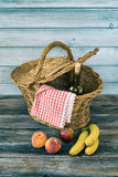 Picnic Basket. With fresh fruit and bottle of wine Royalty Free Stock Images