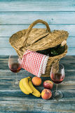 Picnic Basket. With fresh fruit and bottle of wine Stock Image