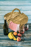 Picnic Basket. With fresh fruit and bottle of wine Stock Photos
