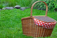 Picnic Basket On The Fresh Summer Lawn Stock Images