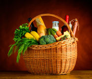 Picnic Basket with Fresh Vegetables and Fruits royalty free stock photos