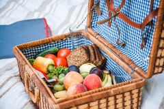Picnic basket with fruit and bread close up stock photo
