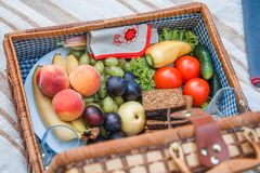 Picnic basket with fruit and bread close up stock photos
