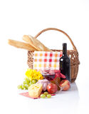 Picnic basket with fruit bread and wine. Stock Photo