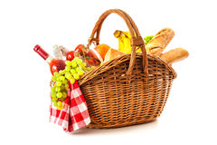 Picnic basket with fruit bread and wine. Isolated on white Stock Photography
