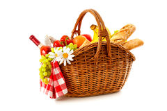 Picnic basket with fruit bread and wine Stock Photos