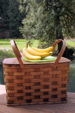 Picnic basket and fruit outdoors Stock Photo