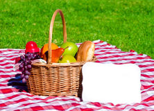 Picnic basket with fruits Stock Photography