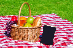 Picnic basket with fruits and blank Royalty Free Stock Photography