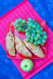 Picnic basket with fruits, bread and bottle of Royalty Free Stock Images