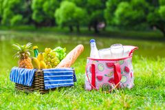 Picnic basket with fruits, bread and bottle of Stock Photo