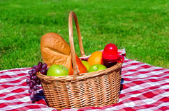 Picnic basket with fruits Royalty Free Stock Image