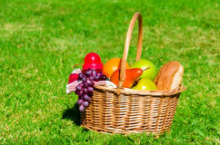 Picnic basket with fruits Stock Image