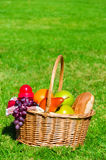 Picnic basket with fruits Royalty Free Stock Images