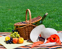 Picnic basket with fruits . Stock Photo