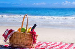 Picnic basket with fruits by the ocean. Picnic background with basket and fruits by the ocean Royalty Free Stock Photography