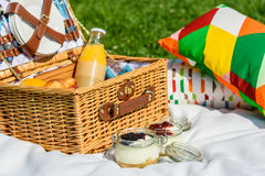 Picnic Basket With Fruits, Orange Juice, Croissants And No Bake Blueberry And Strawberry Cheesecake Royalty Free Stock Photo