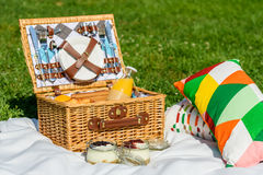 Picnic Basket With Fruits, Orange Juice, Croissants And No Bake Blueberry And Strawberry Cheesecake Royalty Free Stock Photography