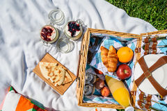 Picnic Basket With Fruits, Orange Juice, Croissants, Quesadilla And No Bake Blueberry And Strawberry Cheesecake Royalty Free Stock Photography