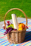 Picnic basket with fruits Royalty Free Stock Photos