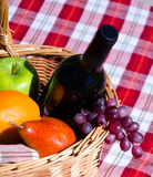 Picnic basket with fruits and wine Stock Image