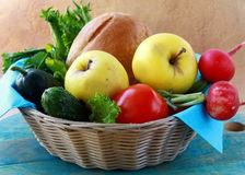 Picnic basket full of fresh food bread, fruit. And vegetables Royalty Free Stock Photography
