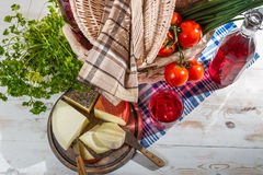 Picnic basket full of healthy and fresh produce Royalty Free Stock Images