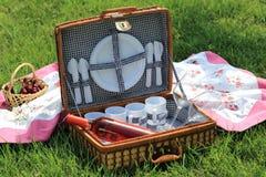 Picnic basket in a garden Stock Photography