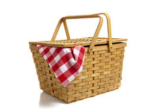 Picnic Basket with Gingham. A wicker picnic basket with a red gingham cloth on a white background Stock Image