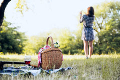 Picnic basket and girl in background stock photography