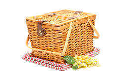 Picnic Basket, Grapes and Folded Blanket Isolated. On a White Background Royalty Free Stock Photography