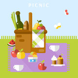 The picnic basket on the grass. Picnic basket with different food. Vector flat illustration Royalty Free Stock Image