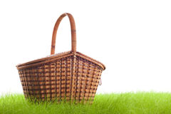 Picnic basket on the grass Royalty Free Stock Photos