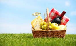 Picnic basket on green field Royalty Free Stock Photo