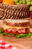 Picnic basket ham and cheese sandwich close up. Summer picnic basket ham and cheese sandwich Royalty Free Stock Image