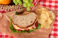 Picnic basket ham and cheese sandwich top view. Summer picnic basket ham and cheese sandwich Royalty Free Stock Image